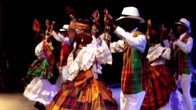 a caribbean dance ensemble dances afro-caribbean dances - アフリカ系カリブ人点の映像素材/bロール