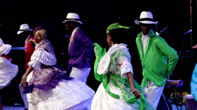 a caribbean dance ensemble dances afro-caribbean dances - traditional clothing stock videos & royalty-free footage