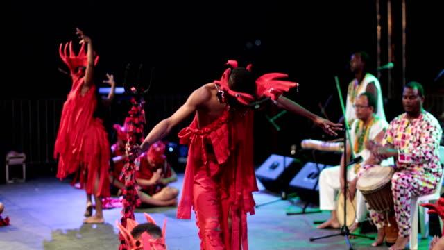 a caribbean dance ensemble dances afro-caribbean dances - 干草用熊手点の映像素材/bロール