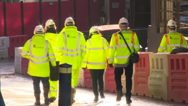 no bonuses for directors following liquidation england ext various of workers at construction site wearing carillion high viz jackets construction... - liquidation stock videos and b-roll footage