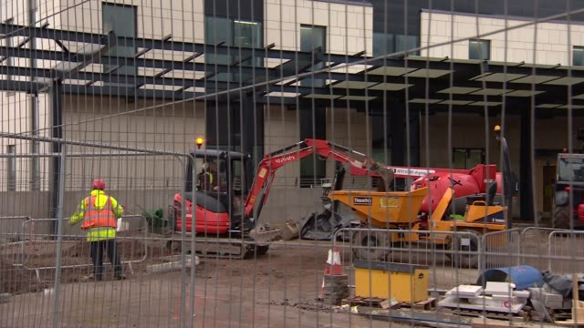 Liverpool EXT Various shots of mechanical diggers at construction site for Royal Liverpool University Hospital Construction vehicles Sign 'Carillion'...