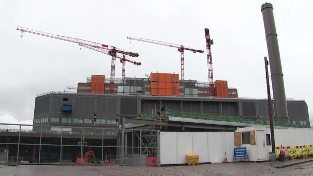 West Midlands Birmingham EXT Various shots of cranes standing idle at construction site for Midland Metropolitan Hospital Reporter to camera...