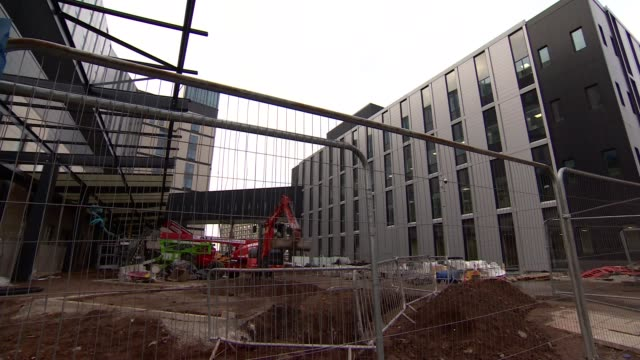 carillion goes into liquidation liverpool ext construction site for royal liverpool university hospital sign 'carillion' with graffiti reading 'bust'... - liquidation stock videos and b-roll footage