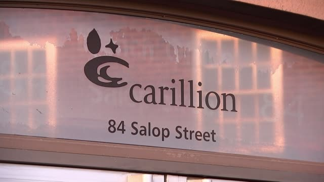Jerry Swain interview SOT Wolverhampton Sign 'Carillion Making tomorrow a better place' on side of building Sign 'Carillion 84 Salop Street'...