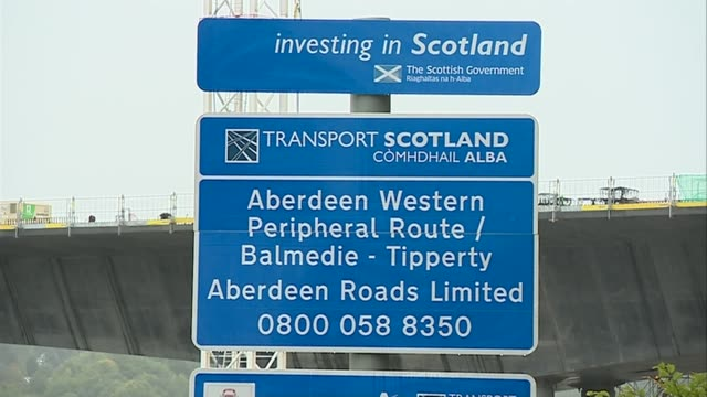 carillion goes into liquidation scotland aberdeen ext roller along on carillion road project sign for scottish road bridge under construction workers... - liquidation stock videos and b-roll footage