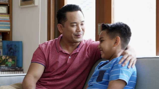 caring father talking to son at home - malay family stock videos and b-roll footage