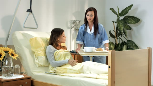hd: caring nurse serving food - disability services stock videos & royalty-free footage