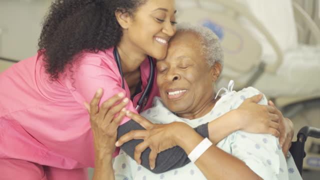 caring nurse with senior patient - nursing home stock videos & royalty-free footage