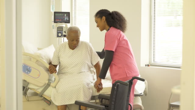caring nurse with senior patient - service stock videos & royalty-free footage
