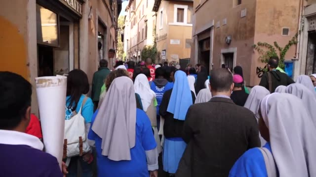 caritas launches in rome a symbolic one million kilometre pilgrimage around the world with migrants and refugees to share the journey and change... - kilometre stock videos & royalty-free footage