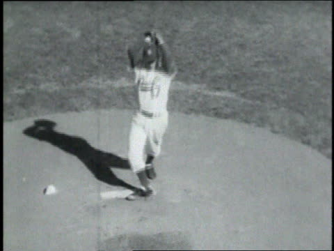 carl erskine pitching / batter swinging and missing / crowd cheering - ebbets field video stock e b–roll