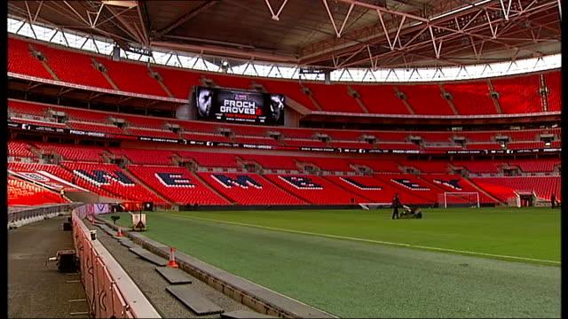 wembley stadium / eddie hearn interview england london wembley stadium ext general views of wembley stadium pitch and stands with banner 'froch vs... - ウェンブリー・スタジアム点の映像素材/bロール