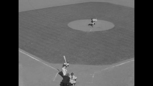 carl furillo brooklyn dodgers at bat in game 1 of the world series / edward whitey ford new york yankees winds up and pitches / high angle ls furillo... - ebbets field video stock e b–roll
