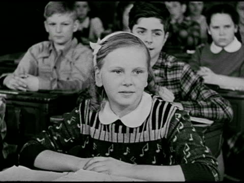 vídeos de stock e filmes b-roll de classroom dramatization 'carl norcross' completing science experiment class watching vs children's choir sitting in chairs singing well groomed 'carl... - 1947