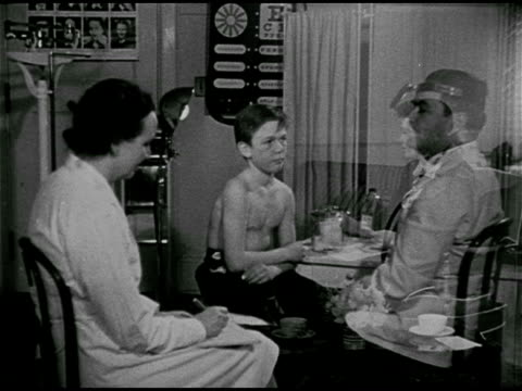 DRAMATIZATION 'Carl Norcross' having medical checkup w/ male doctor female teacher visiting w/ 'Carl's' parents at home CU Book 'Childhood Education'...