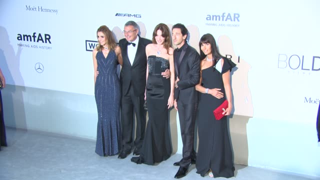Carla Bruni Adrien Brody JeanChristophe Babin at AmfAR Red Carpet at Hotel du CapEdenRoc on May 22 2014 in Cap d'Antibes France
