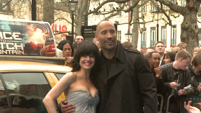 carla gugino and dwayne johnson at the race to witch mountain uk premiere at london - witch stock videos & royalty-free footage
