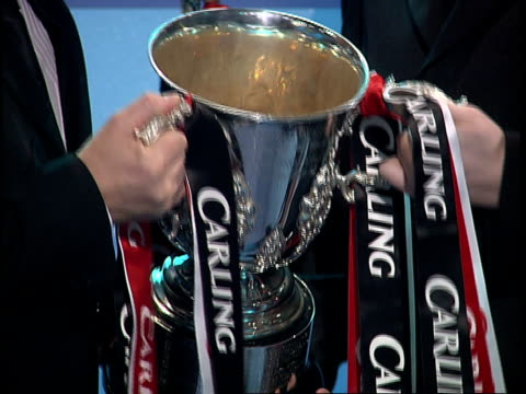 Preview Arsenal v Chelsea ENGLAND London GIR INT Hands holding Carling Cup football trophy as tilt the silver cup