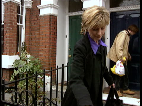 england london ms julia carling coming out of house track back as twds central london ms alan kaufmann along street pan l as enters office building - julia carling stock videos and b-roll footage