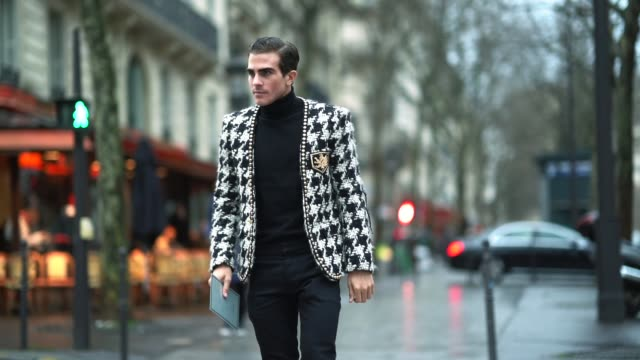 carlo sestini wears a black and white jacket a black turtleneck black pants black shoes outside balmain during paris fashion week menswear fall... - turtleneck stock videos & royalty-free footage