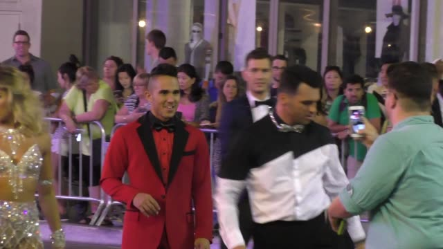 Carlos PenaVega Tony Dovolani filming Dancing With The Starsflash mobon Hollywood Blvd in Hollywood on September 10 2015 in Los Angeles California
