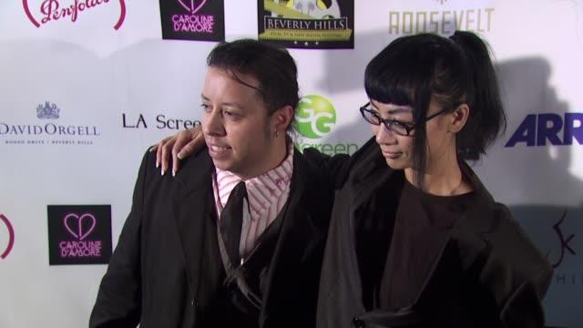 vídeos de stock, filmes e b-roll de carlos ramirez bai ling at the beverly hills film tv new media festival opening night gala at hollywood ca - bai ling