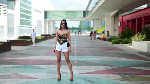 carlota sanchez wears bershka shoes, stradivaius trousers and zara shirt at ifema on july 08, 2019 in madrid, spain. - bershka designer label点の映像素材/bロール