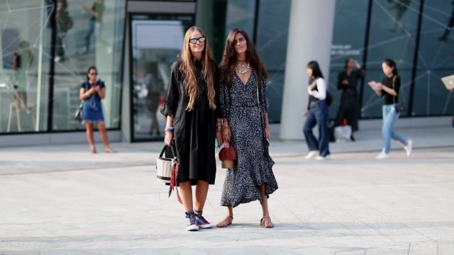 carlotta oddi wearing black dress, basket bag and chiara totire wearing navy dress with dots print is seen outside alberta ferretti during milan... - black dress stock videos & royalty-free footage