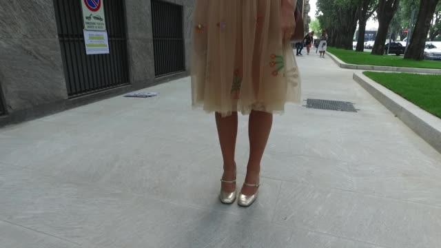 Carlotta Rubaltelli wearing Miahatami dress Chloe bag Giovanni Fabiani shoes Moscot sunglasses on September 23 2016 in Milan Italy