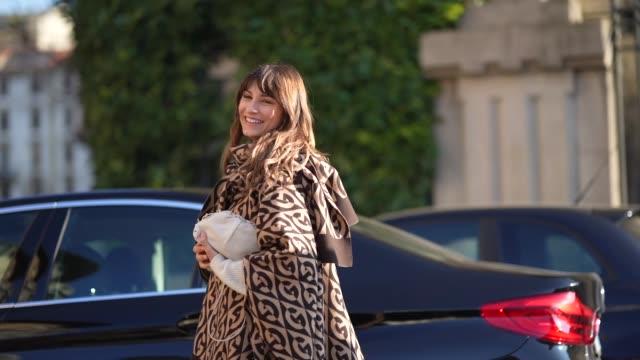 carlotta rubaltelli wears a brown poncho with printed geometric patterns, blue pants, outside ferragamo, during milan fashion week menswear... - milan fashion week stock videos & royalty-free footage