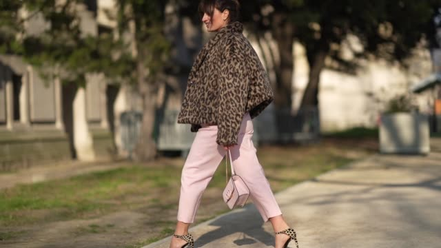 carlotta rubaltelli wears a red pullover, a leopard print winter coat, pale pink pants, red shoes, a valentino bag, outside elie saab, during paris... - paris fashion week - haute couture spring/summer 2020点の映像素材/bロール