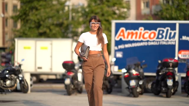 carlotta rubaltelli wears fringed and glitter glasses a white cropped tshirt a bag brown pants shoes outside the alberta ferretti show during milan... - spring summer collection stock videos & royalty-free footage