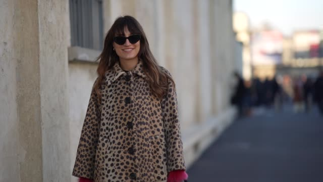 carlotta rubaltelli wears sunglasses a brown leopard print long coat black leather gloves a mini bag black leather high boots pink fluffy sleeves... - sunglasses stock videos & royalty-free footage