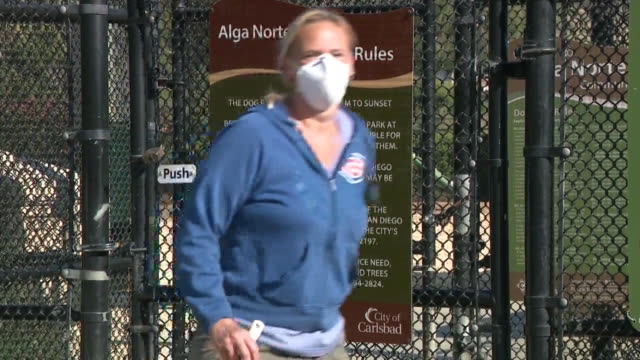 carlsbad, ca, u.s. - dog park rules amid the coronavirus pandemic on wednesday, may 20, 2020. - carlsbad california stock videos & royalty-free footage