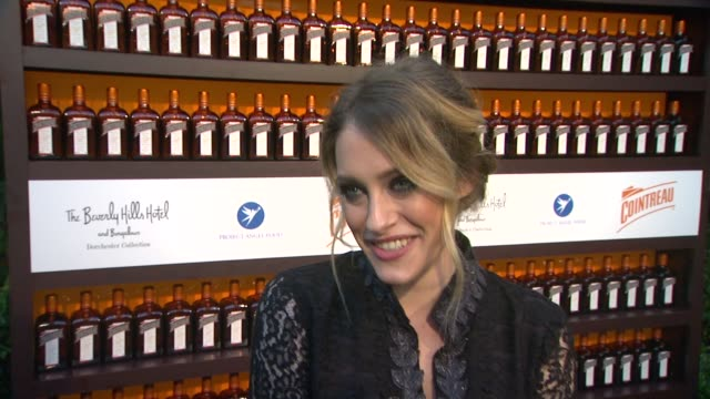 carly chaikin on why she is there, her plans this summer and her favorite olympic sport at cointreau and dita von teese launch cointreau poolside... - beverly hills hotel stock videos & royalty-free footage