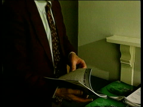 carmarthen: int cms plaid cymru election literature on table l-r cynog dafis mp clicking through leaflet cf = b0551052 or b0543823 19.24.20 to... - literature stock videos & royalty-free footage