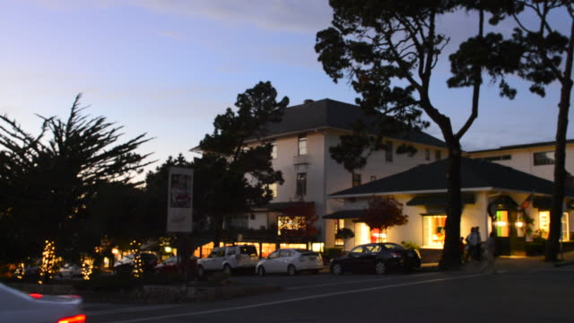 carmel california exclusive small expensive city near pebble beach on ocean avenue in city center at twilight - carmel california stock videos & royalty-free footage