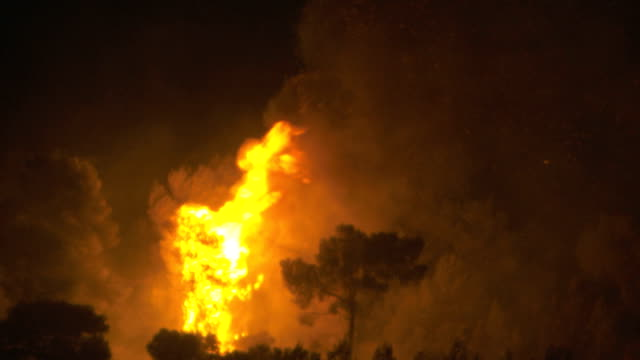 carmel mountain fire at night as seen from the southern areas of haifa a few hours after it begun / cu flames burning in wooded area israeli wildfire... - woodland stock videos & royalty-free footage