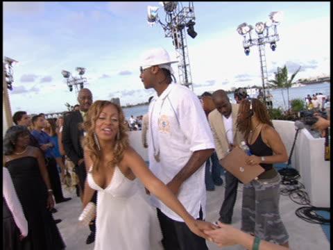 vídeos de stock, filmes e b-roll de carmelo anthony and la la vasquez arrive to the 2005 mtv video music awards preshow no audio - 2005