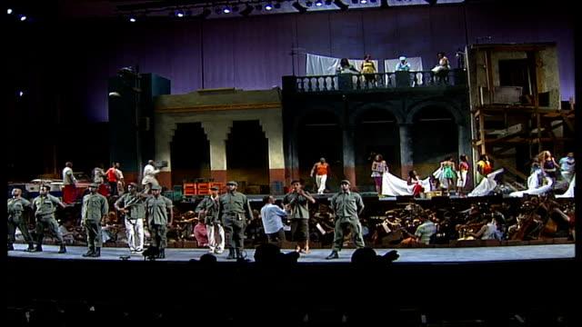 carmen jones opens at the royal festival hall; actors on stage during rehearsal for the musical 'carmen jones' ends - ロイヤルフェスティバルホール点の映像素材/bロール