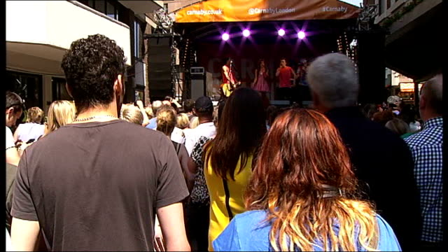Carnaby Street festival **Music heard SOT** Various of 'Luminites' performing on stage