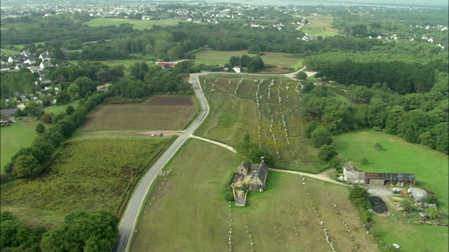 aerial, carnac stones and view of village, carnac, brittany, france - prehistoric era stock videos & royalty-free footage