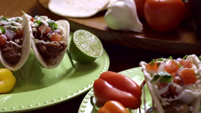 carne asada street tacos with cotija cheese, onion and cilantro - sour cream stock videos and b-roll footage