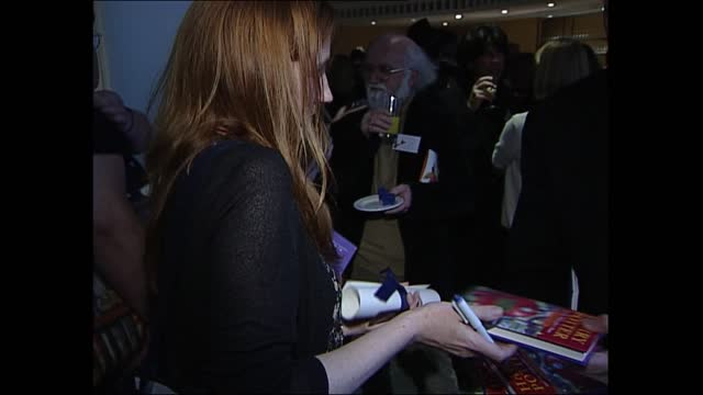 carnegie book awards; england: london: british library: int side jk rowling signing autograph rowling signing book for nick glass rowling autographs... - sign stock videos & royalty-free footage