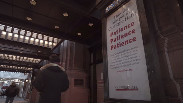 "carnegie hall entrance with closed ""patience patience patience"" sign. filmed during the coronavirus pandemic . - entrance sign stock videos & royalty-free footage"
