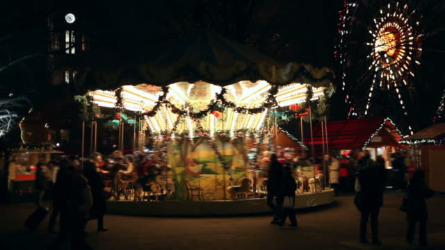 carnival at night  - carousel with may people - fairground stall stock videos & royalty-free footage