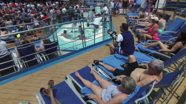 carnival cruise lines gained popularity these years and they did a great job providing high quality services to meet different tourists needs - sunbathing stock videos & royalty-free footage