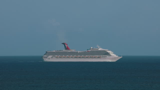 ws carnival cruise ship sailing in sea / maho beach, st. maarten - kreuzfahrtschiff stock-videos und b-roll-filmmaterial