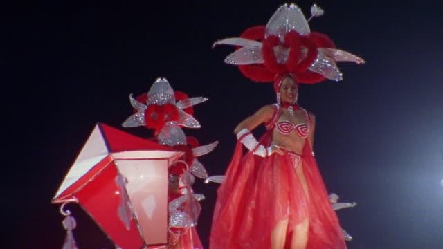 LA, SHAKY, Carnival dancers on parade float at night, Santiago de Cuba, Cuba