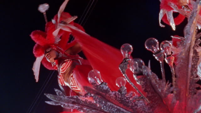 LA, PAN, Carnival dancers on parade float at night, Santiago de Cuba, Cuba